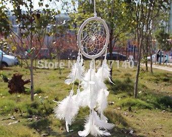 Dream catcher made with beautiful white feathers and leather wrapped