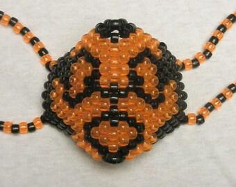 Orange and black biohazard kandi mask- handmade, fashion, accessories, edm, edc, biohazard sign, rave, raver, rave mask
