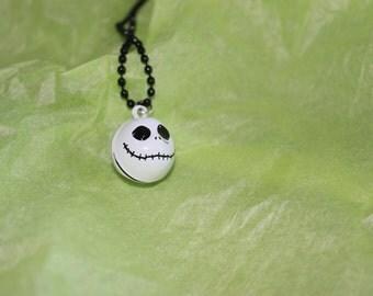 skeleton bell necklace