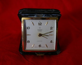Vintage Handwind travel alarm clock by Junghans - Metal and Leather case