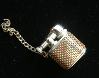 60's novelty moveable part lighter key fob by Renown. 1 ins square.