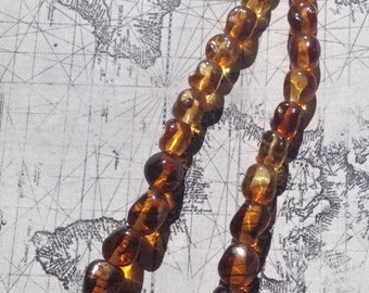 Ovoid Baroque Amber-coloured Glass Graduated Beads C 1960s
