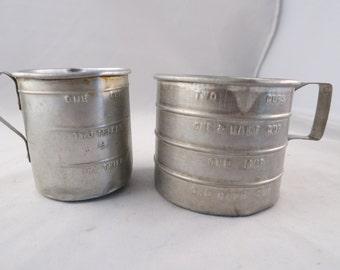 Two  Vintage Rustic/Farmhouse  Aluminum Measuring Cups