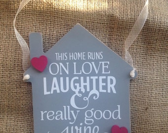 This Home Runs on Love, Laughter and Really Good Wine House Shaped Hanging Plaque