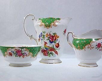 3 Old Paragon Rockingham Porcelain Green Exotic Bird Milk Pitcher Creamer Set