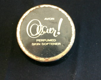 Vintage Avon perfumed skin softener container.  Black with gold lid.  Empty.