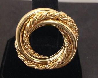 Napier gold tone spiral brooch