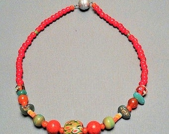 """handmade necklace with red coral beads and large Jatim bead """"June"""""""