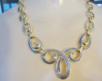 Gold Tone Necklace with Purple Accents