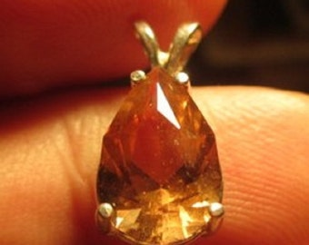 7.7 x 11.8mm pendant, golden topaz