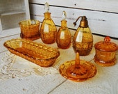 Art Deco Bathroom Vanity Perfume Set or Toilet Set With Floral Decor - 7 Piece Art Deco Vanity Set in Amber Colored Pressed Glass - 1950s