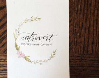 """Handlettered Calligraphy Quote Print with Floral Wreath Detail- """"Introvert: Proceed With Caution"""""""