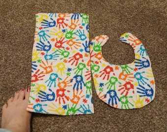 Hand print bib and burp cloth set.