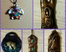 Clay pendant . Choice of goddess, tree of life, turquoise square, elephant or turtle.