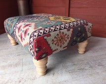 Handcrafted footstool with Aztec pattern fabric