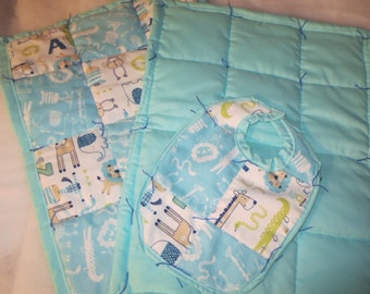 Two hand made burp cloths with matching bib.