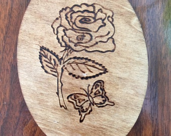 Floral butterfly woodburned design