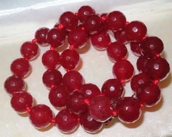 Lovely raw ruby knotted necklace 10mm stones