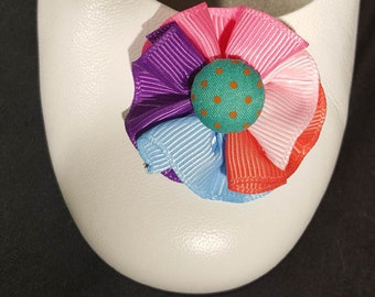 Shoe Clips Multi-color pinwheel with pink buttons on French Bluette shoe clips. Available with green buttons.
