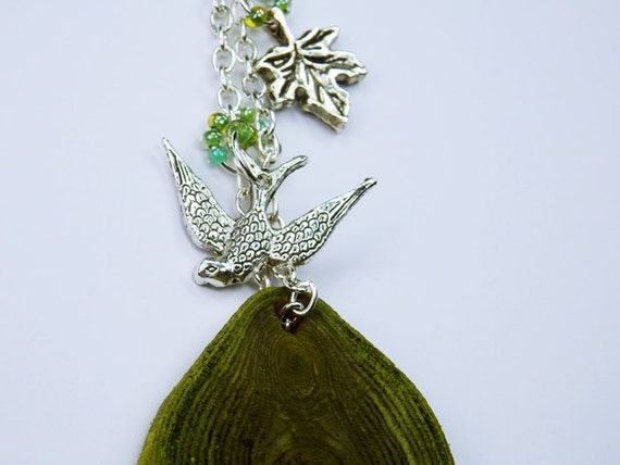 Necklace Tree Dreams-with bird and leaf necklace of green olive wood with silver-colored swallow on black leather strap Jewelry Wood