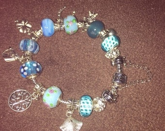 """Silver and turquiose 8"""" charm bracelet"""