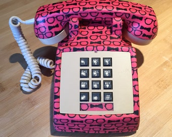 Old phone to dial vintage, old phone to retro antique roulette table pink and beige with fabric bow tie
