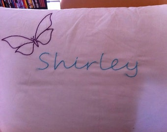 Hand embroidered pillowcase with butterfly name.