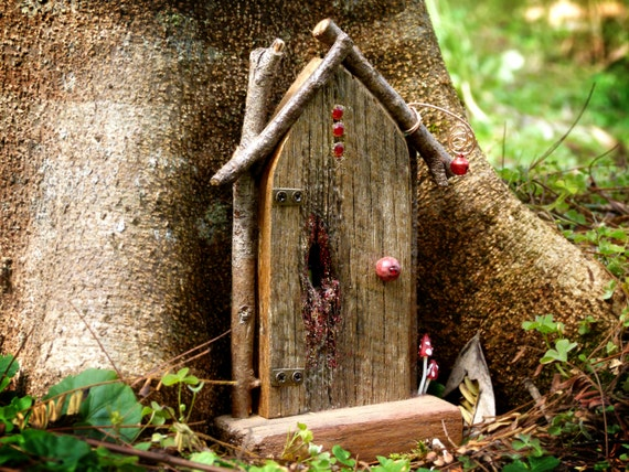 Rustic wooden arched fairy door with with red bell twig for Wooden fairy doors