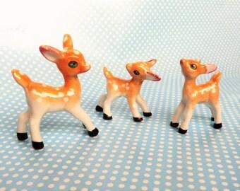 Three deer figurines, lustreware bone china.