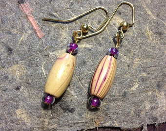 Wooden earrings with purple accents