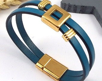 turquoise leather strap double with beaded geometric flashed gold