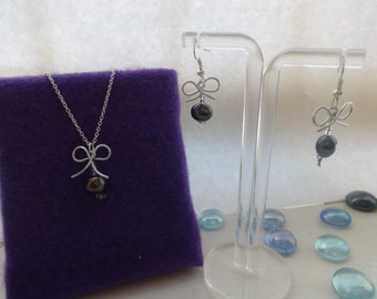 purple bow and pearl jewellery set