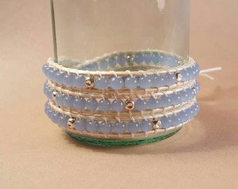 Light blue and sterling silver plated leather wrap bracelet