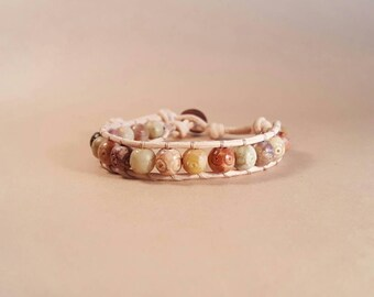 Carved picture jasper and leather beaded bracelet
