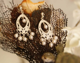 Romantic solid silver chandelier earrings enhanced with white freshwater pearls