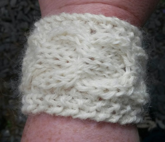 Aran Cuff: seamless knitted bracelet with eternity cable. Cosy pure wool. Can be worn with cable facing either way; original design. Unisex.