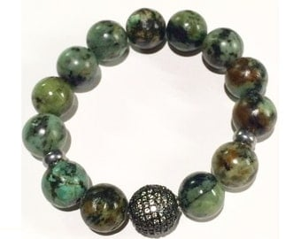 12mm African Turquoise with one 14mm Rhodium plated Micro Pave' CZ bead bracelet