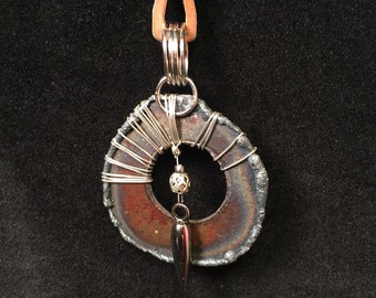 Metal steel wire wrapped pendant necklace with cut-out center and charm
