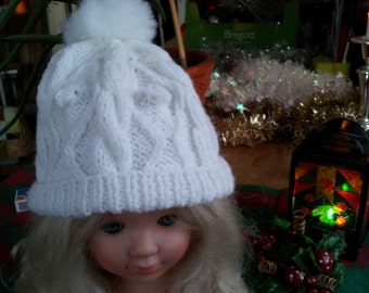 Knitted white baby cap