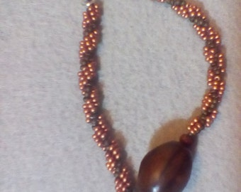 Spiral bracelet with a wooden bead