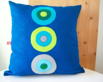 three dotted blue pillow