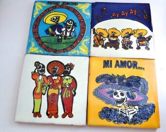 set of 4 vintage hand-painted Mexican sugar skull terra cotta tiles