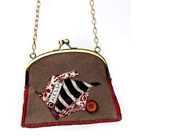 Handbag retro clip closure
