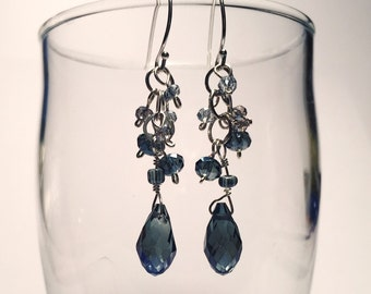 Smoky blue teardrop crystal dangle earrings on sterling silver