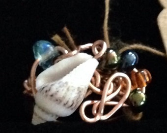 copper ring with shell and glass beads