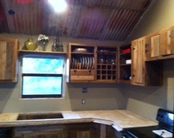 Kitchen cabinets built from reclaimed wood