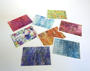 9 postcards illustrated with reproductions of marbled paper