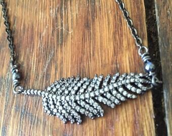 Sparkly gunmetal pave leaf necklace