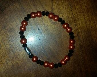 Cute orange and black beaded bracelet