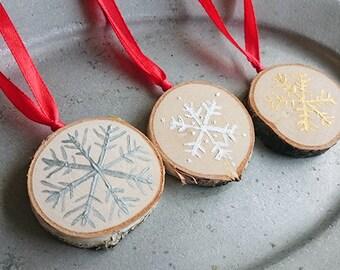 Set of 3 snowflake ornaments on wood
